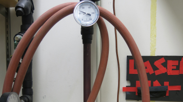 Image of gas gauge and hose in lab